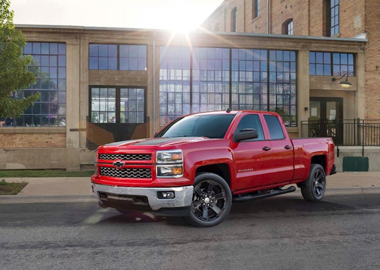 two wide 2015 chevy 1500 silverado front three quarter red one
