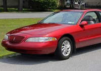 two wide 1998 lincoln mark viii lsc in red  front left 2