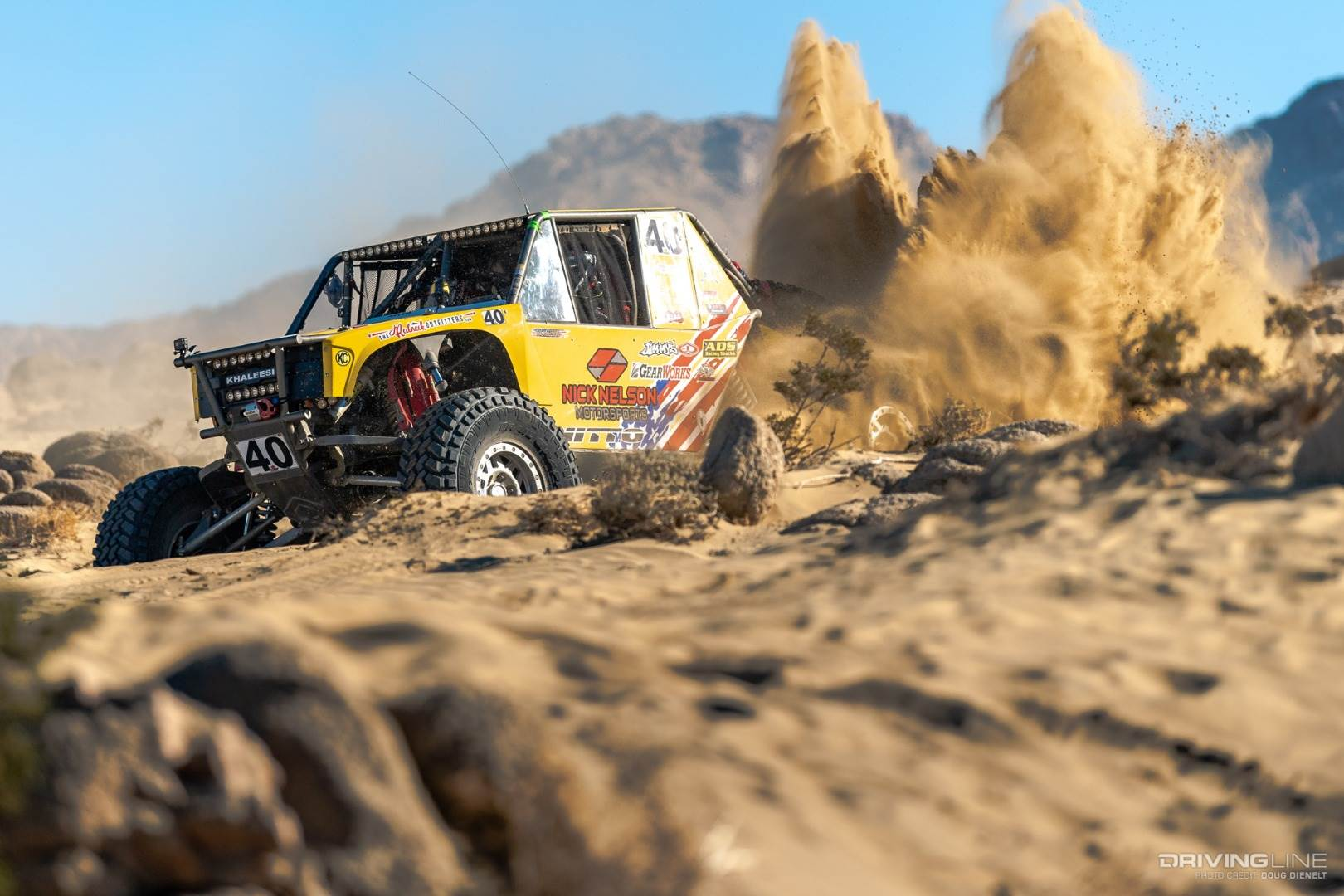 Nick Nelson's rig kicking up dirt in the desert